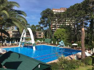 The swimming pool at or near Complejo Arcobaleno