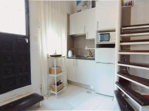A kitchen or kitchenette at Magnifico Duplex