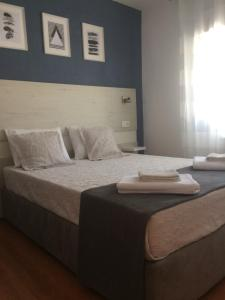 A bed or beds in a room at My City House