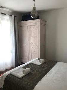 A bed or beds in a room at Villa Caramac