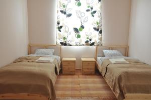 A bed or beds in a room at Bokros Vendégház