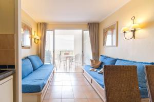 Coin salon dans l'établissement Village Pierre & Vacances - Les Restanques du Golfe de Saint Tropez