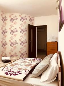 Postel nebo postele na pokoji v ubytování Villa CC
