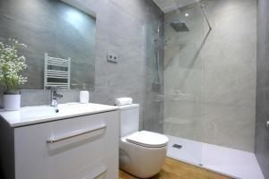 A bathroom at Prim Suite Apartment