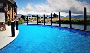 The swimming pool at or near Apart Villa Huapi