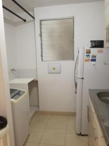 A kitchen or kitchenette at Apartamento Vacacional