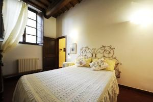 A bed or beds in a room at Torregalli