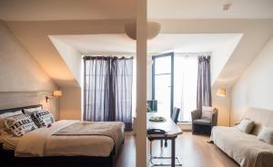 Postel nebo postele na pokoji v ubytování Aparthotel AXL Flathotel Continental Stay