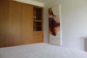 A bed or beds in a room at Casa de Coyra