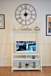 Een TV en/of entertainmentcenter bij The Pembroke - yourapartment