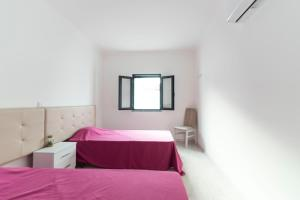 A bed or beds in a room at Villa UA