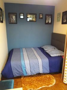 A bed or beds in a room at Le Watson