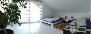 """A bed or beds in a room at Ferienwohnung""""VIP MUNICH ALBATROS DE LUXE"""""""
