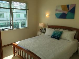 A bed or beds in a room at Princes Wharf Apartment Auckland City CBD