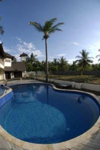 The swimming pool at or near Baruna Villas