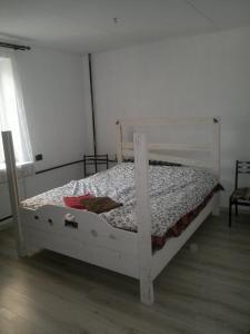 Кровать или кровати в номере Апартаменты на Красноармейской