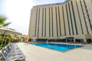 The swimming pool at or near Bin Majid Acacia Hotel and Apartments