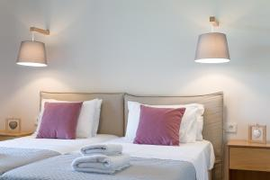 A bed or beds in a room at Lemonia Accommodations