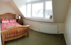 A bed or beds in a room at Badarroch Cottage