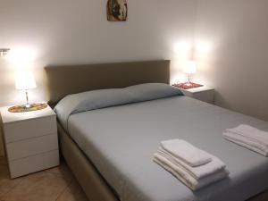 Letto o letti in una camera di Golden House