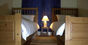 A bed or beds in a room at Saltpans Self Catering
