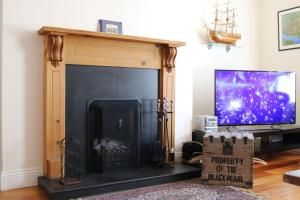 A television and/or entertainment center at Saltpans Self Catering