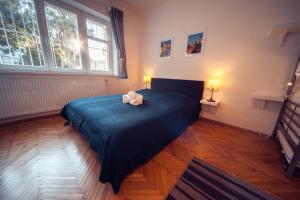 Кровать или кровати в номере Residence Strážní no. 16
