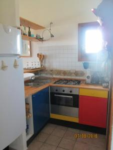 A kitchen or kitchenette at Casa Juvele