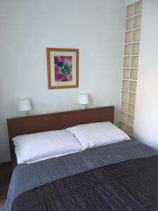 A bed or beds in a room at Apartmán 108