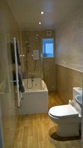 A bathroom at Dairy Cottage