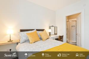A bed or beds in a room at Sweet Inn - Gorgeous Howth I