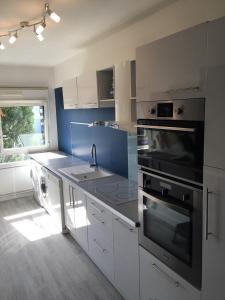 Cuisine ou kitchenette dans l'établissement Les jardins de champagne I