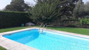 The swimming pool at or near Teomil - Casa de Férias