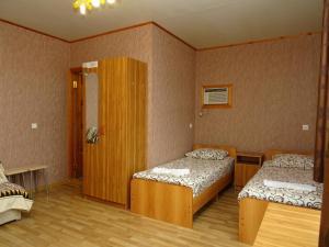 Кровать или кровати в номере Гостевой дом Камилла