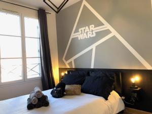 Un ou plusieurs lits dans un hébergement de l'établissement La Suite Star Wars - SDP