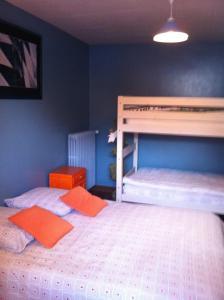 Un ou plusieurs lits superposés dans un hébergement de l'établissement Gîtes Le Mascaret