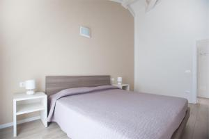 A bed or beds in a room at Terrazze sul Garda
