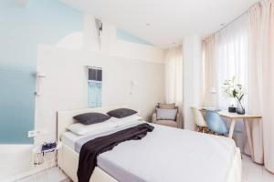 法蘭克福古特魯大街美景公寓房間的床