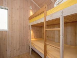 A bunk bed or bunk beds in a room at Holiday home Moreavej