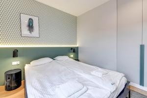 A bed or beds in a room at Apartinfo Aura Island