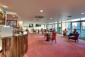 A restaurant or other place to eat at Emirates Grand Hotel Apartments