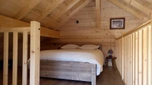 Un ou plusieurs lits dans un hébergement de l'établissement Le chalet des Pierres