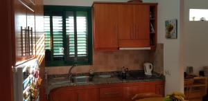 A kitchen or kitchenette at Rosa Private Apt. near beach/wifi free.