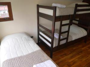 A bunk bed or bunk beds in a room at Casas Turismo Magallanes