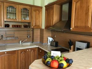 A kitchen or kitchenette at ApartComplex Splendid