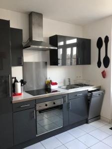 Cuisine ou kitchenette dans l'établissement Casamia