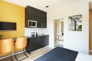 A kitchen or kitchenette at Eiffel Village Apartments Paris