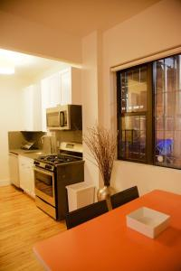 A kitchen or kitchenette at 36th Street Midtown East Luxury Duplex Apartment