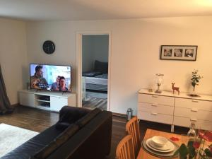 A television and/or entertainment center at Cozy family home with balcony - in hearth of Oslo