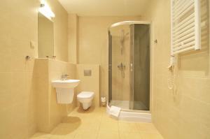 Vonios kambarys apgyvendinimo įstaigoje Spatz Aparthotel